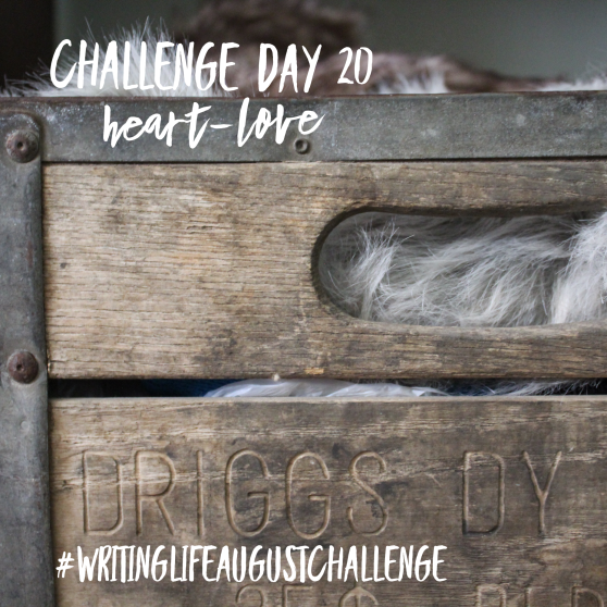 Antique wood and metal milk crate with fur peeking out from the inside. Photo text: Challenge Day 20, heart-love. #writinglifeaugustchallenge